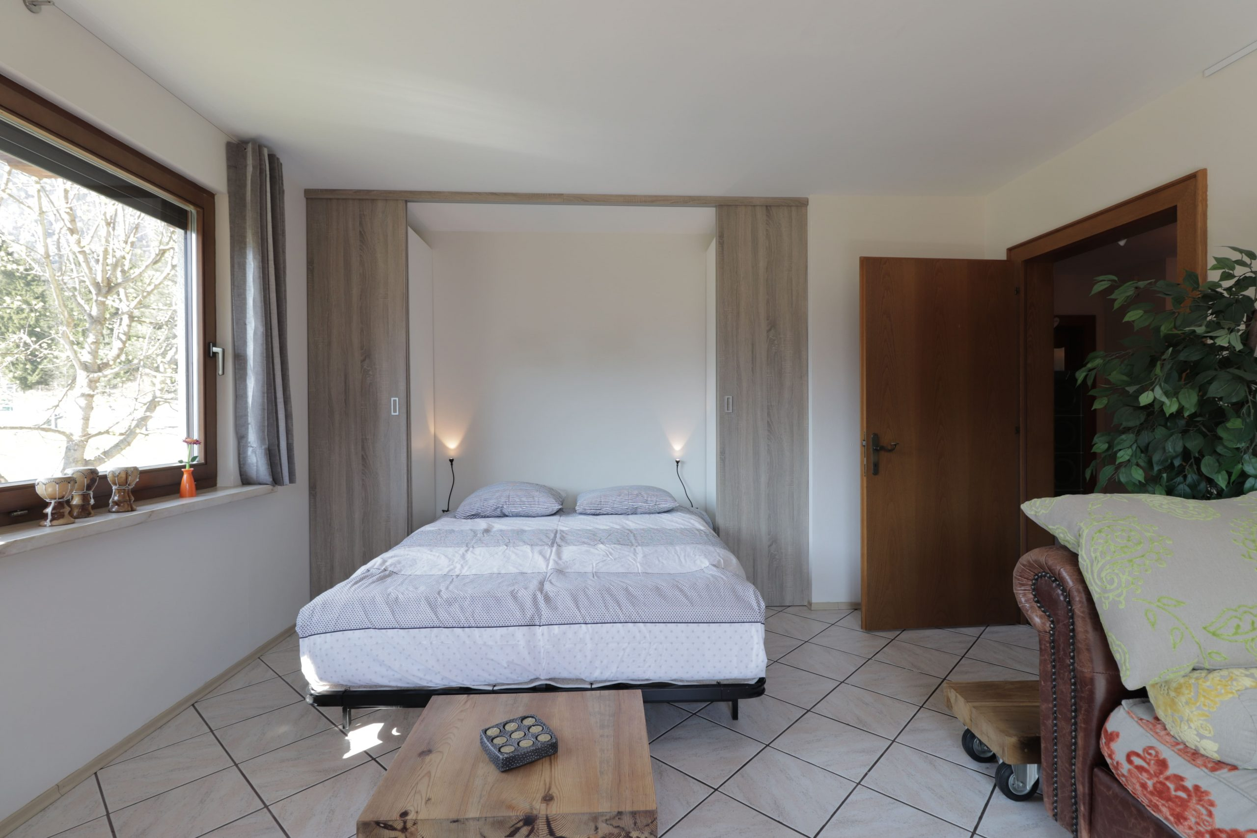 Luxe slaapkamer bergzicht appartement Tom's Hütte